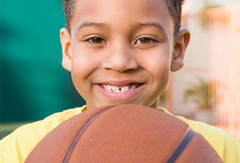 getty_rf_photo_of_smiling_boy_with_basketball