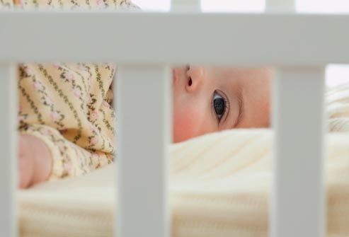 getty_rf_photo_of_baby_in_crib