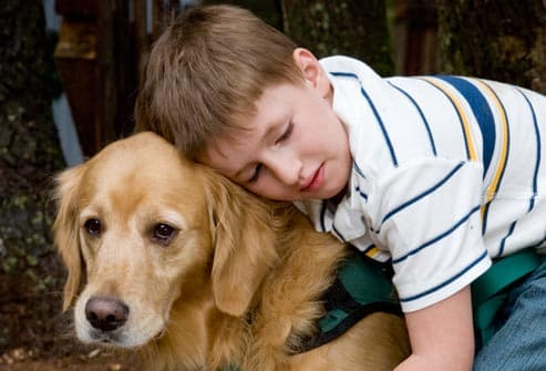 getty_rm_photo_of_autistic_child_with_dog