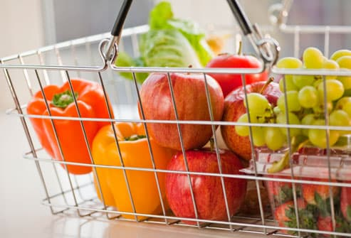 Grocery basket filled with vegetables and fruits