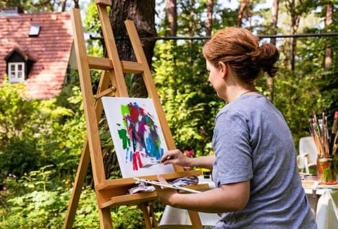 woman painting outside