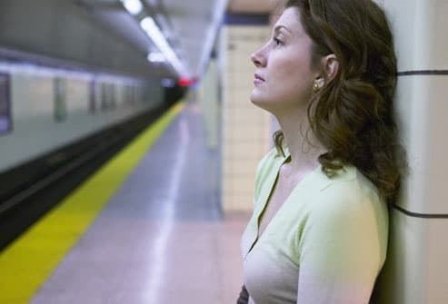 Depressed Woman Waitng For Train