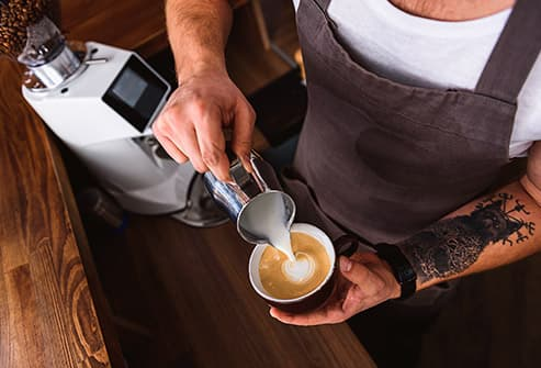 barista making latte
