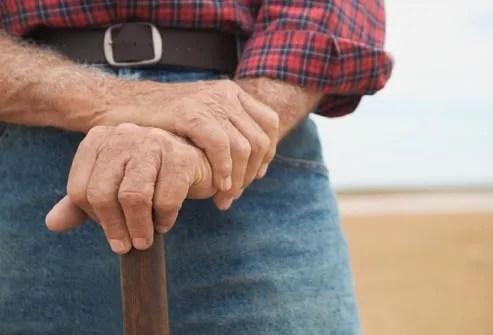 older man with walking stick