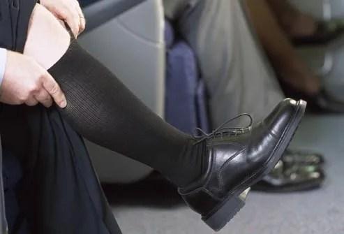 man wearing flight socks on plane