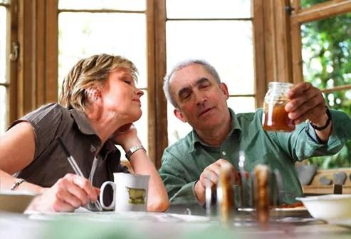 Mature couple discussing honey