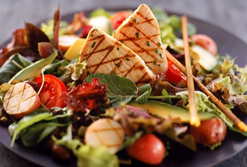 Grilled tuna salad on black plate