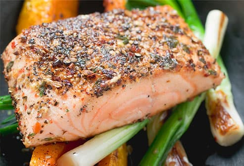 Herb-crusted salmon fillet on vegetables