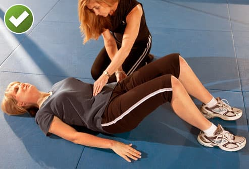 Woman and Trainer Doing Pelvic Tilts