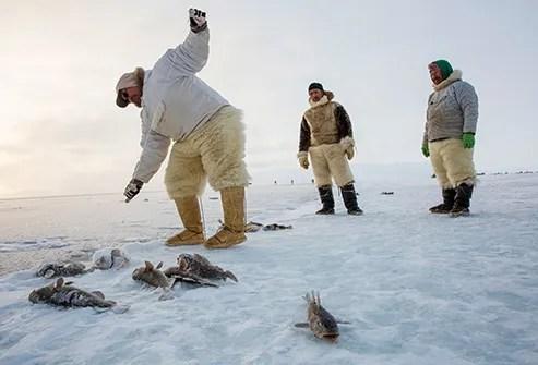 Inuit people fishing