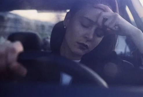 Woman Sitting in Traffic