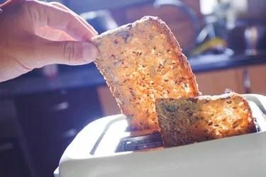 man making toast