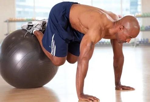 man doing knee tuck