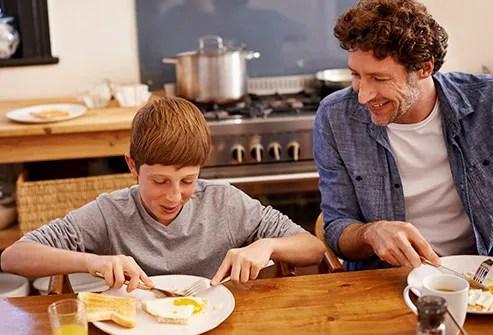 teen eating egg for breakfast