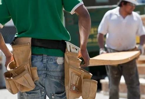 carpenters lifting laminated beams