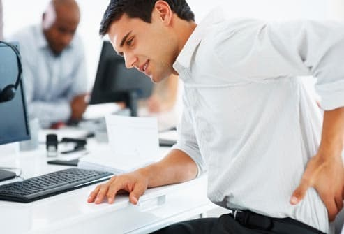 office worker with lower back pain