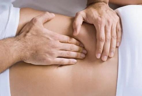 chiropractor adjusting womans spine