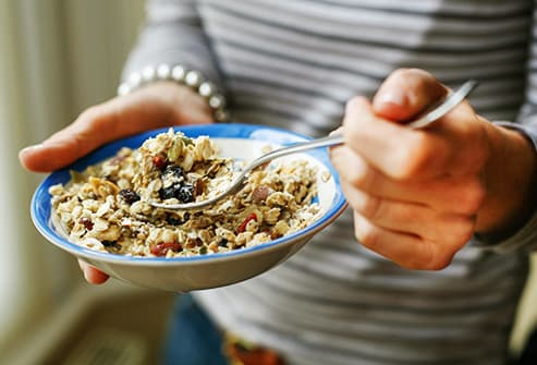 Woman bowl muesli