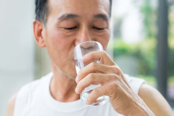photo of mature man drinking water