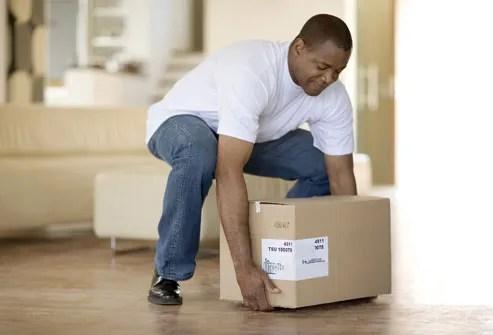 Man about to lift box