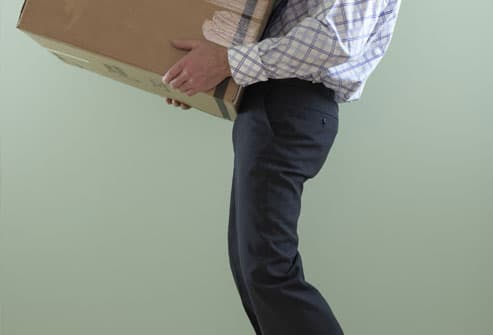 Person lifting heavy box
