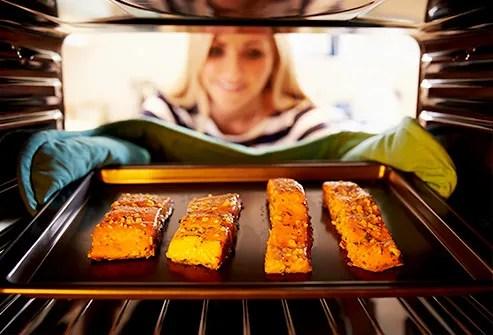 woman baking fish