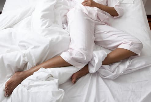 Woman With Restless Leg Syndrome