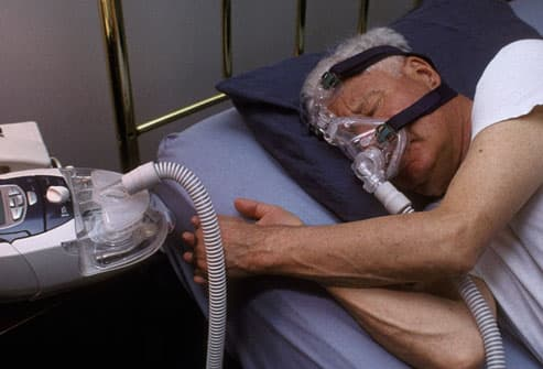 Man With Sleep Apnea using CPAP Device