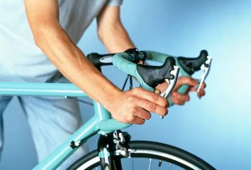 Cyclist Checking Brakes on Bike