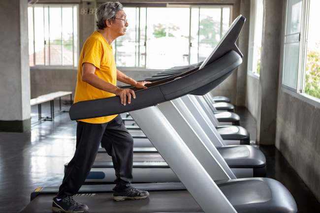 photo of mature man on treadmill