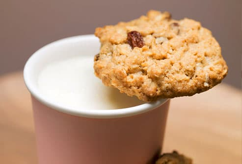 Close up of oatmeal cookie and milk