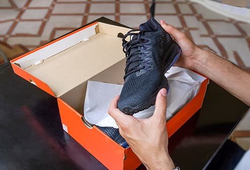 athletic shoe and box
