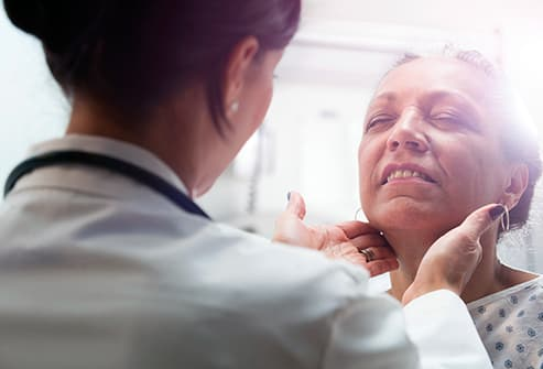 doctor examining senior woman