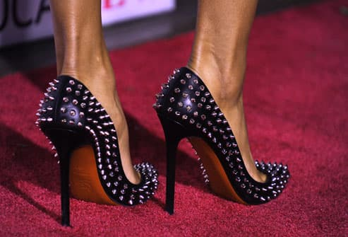 Woman wearing spiked high heels