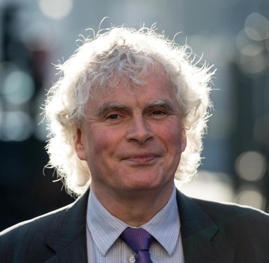 LONDON, ENGLAND - JANUARY 17: Sir Simon Rattle, Music Director Designate, poses for a photo outside London Symphony Orchestra building St. Luke's on January 17, 2017 in London, England. Sir Simon Rattle, Music Director Designate of the London Symphony Orchestra, spoke at a press conference announcing plans for his opening season and future plans of the orchestra. (Photo by Chris J Ratcliffe/Getty Images)