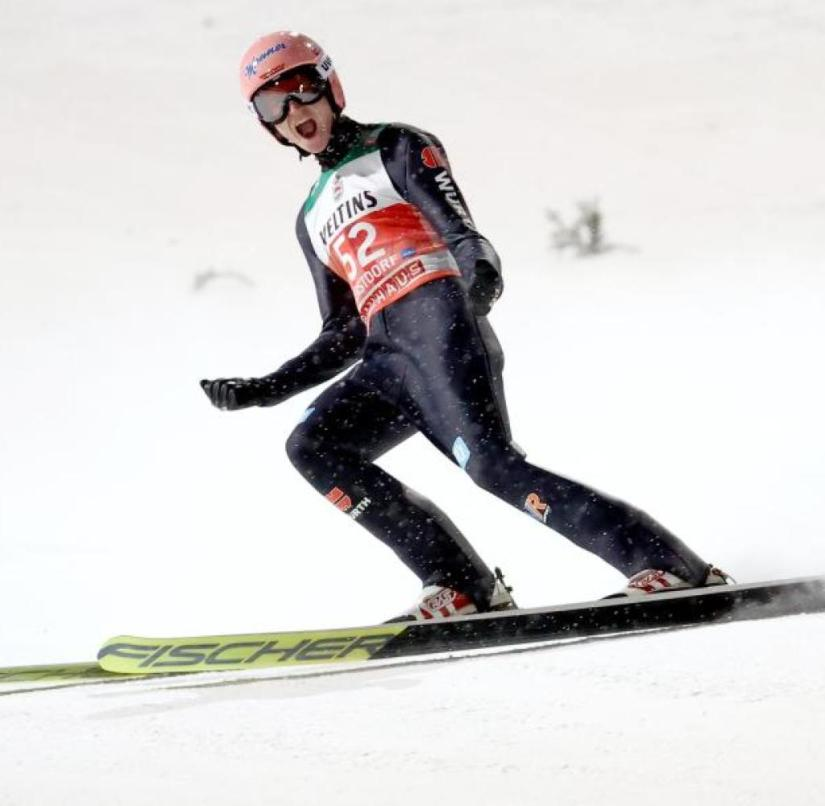 Karl Geiger screams joy after his victory jump