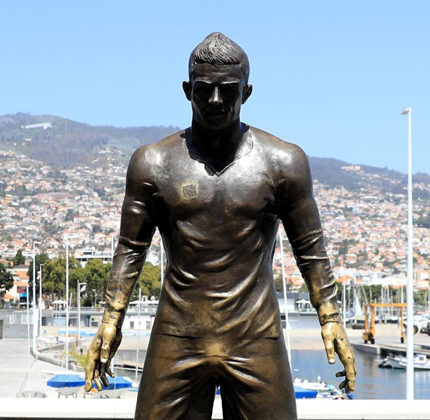 Funchal, Madeira: Fans are so fond of touching the crotch of the statue of Cristiano Ronaldo that it now shines golden