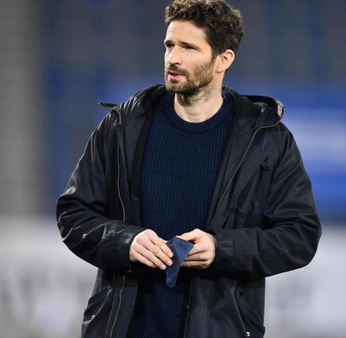 BIELEFELD, GERMANY - JANUARY 10: Arne Friedrich, Performance of Hertha Berlin looks on prior to the Bundesliga match between DSC Arminia Bielefeld and Hertha BSC at Schueco Arena on January 10, 2021 in Bielefeld, Germany. Sporting stadiums around Germany remain under strict restrictions due to the Coronavirus Pandemic as Government social distancing laws prohibit fans inside venues resulting in games being played behind closed doors. (Photo by Stuart Franklin/Getty Images)
