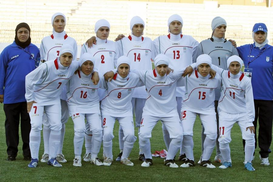File photo of Iranian women's national soccer team posing before withdrawing from their qualifying match against Jordan for the 2012 London Olympic Games in Amman