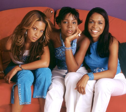 Destiny's Child poses on a couch in Beyonce's house May 20, 2000 in Houston, TX.