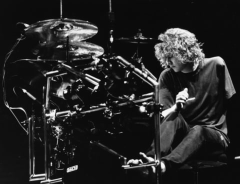 Rick Allen, drummer with the band 'Def Leppard', rehearsing with his modified drum kit to accommodate the loss of his left arm, on stage in Sheffield, England, October 9th 1987.