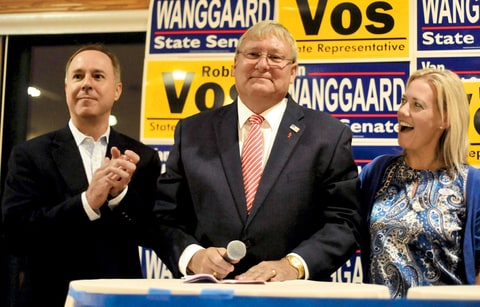 Van Wanggaard talks with supporters Tuesday, Aug. 12, 2014, as Speaker of the Assembly Robin Vos, and state Rep. Samantha Kerkman congratulate him during an election night party in Dover, Wis. Wanggaard, of Racine, was running against Jonathan Steitz in the Republican primary for the seat being vacated by John Lehman.