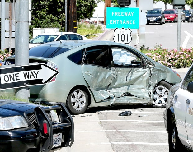 Scene from Kris Jenner car crash in Calabasas in her white Rolls-Royce into a green Prius.