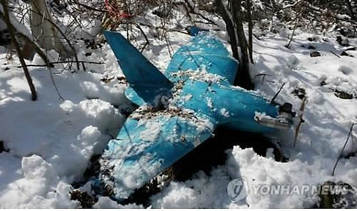 A suspected North Korean drone is shown after being found on a mountain in Samcheok, 290 kilometers east of Seoul, on April 6, in the third such discovery in South Korea in less than a month. (Yonhap)
