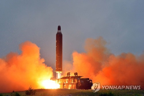 This photo from North Korea's Rodong Sinmun, the ruling party newspaper, on June 23, 2016, shows a Hwasong-10 ballistic missile -- known as the intermediate-range Musudan to the outside world -- being launched near Wonsan on the east coast. (For Use Only in the Republic of Korea. No  Redistribution) (Yonhap)