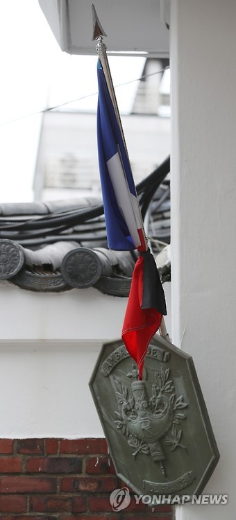 French embassy hoists flag at half-staff