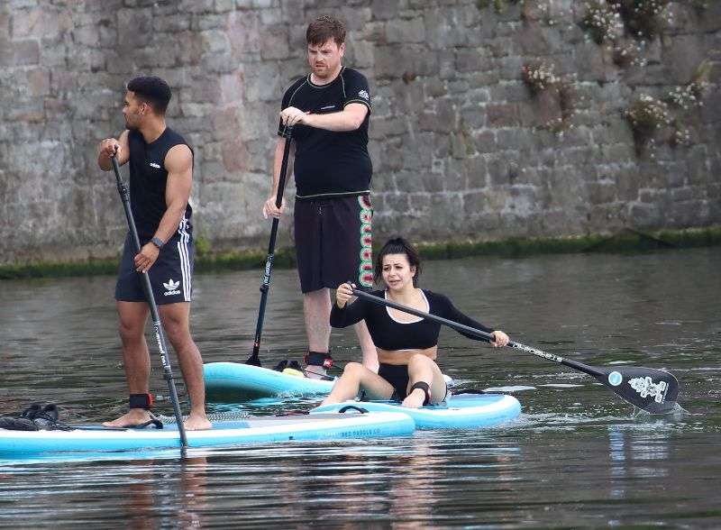 Claudia Fragapane is seen paddleboarding around the harbourside in Bristol