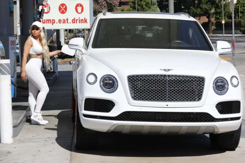 Blac Chyna Sports an all white look while out pumping her own gas in Calabasas