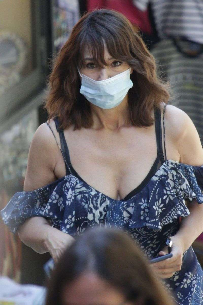 Monica Bellucci Is seen wearing a protective face mask while shopping in Bellagio