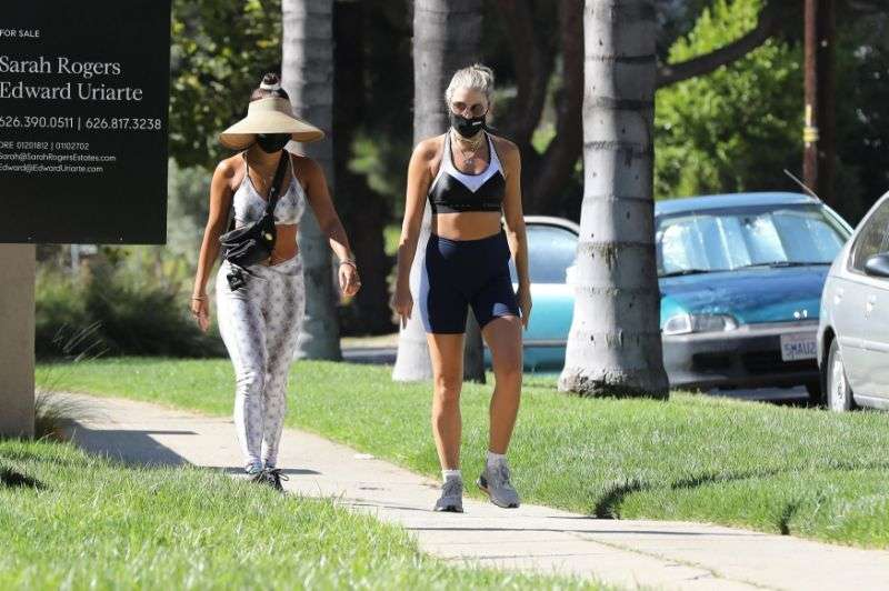 Vanessa Hudgens shows off her fit figure as she enjoys a walk with a friend in Los Angeles